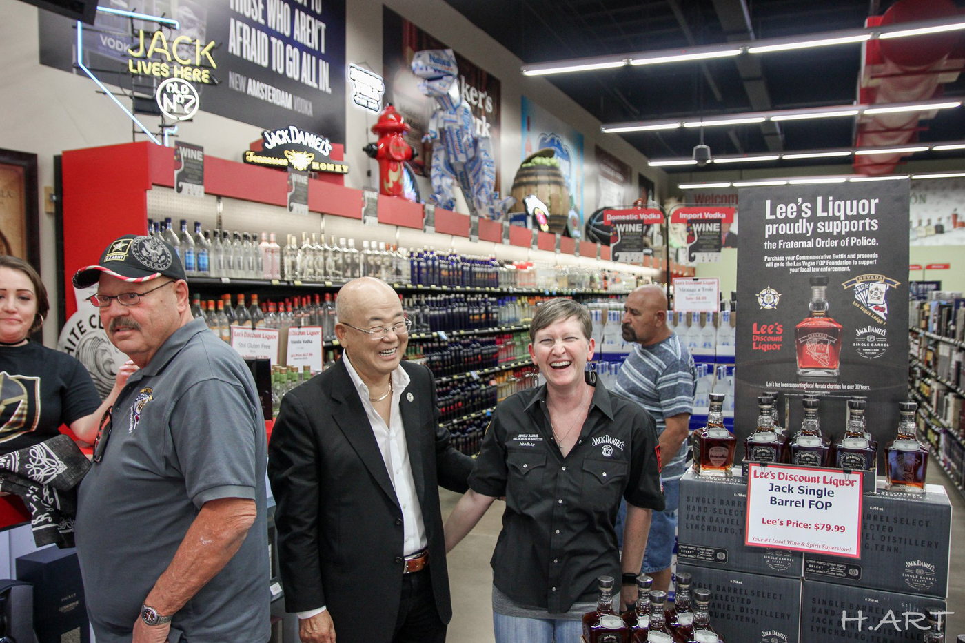 Heather smiling with the owner of Lee's Liquor