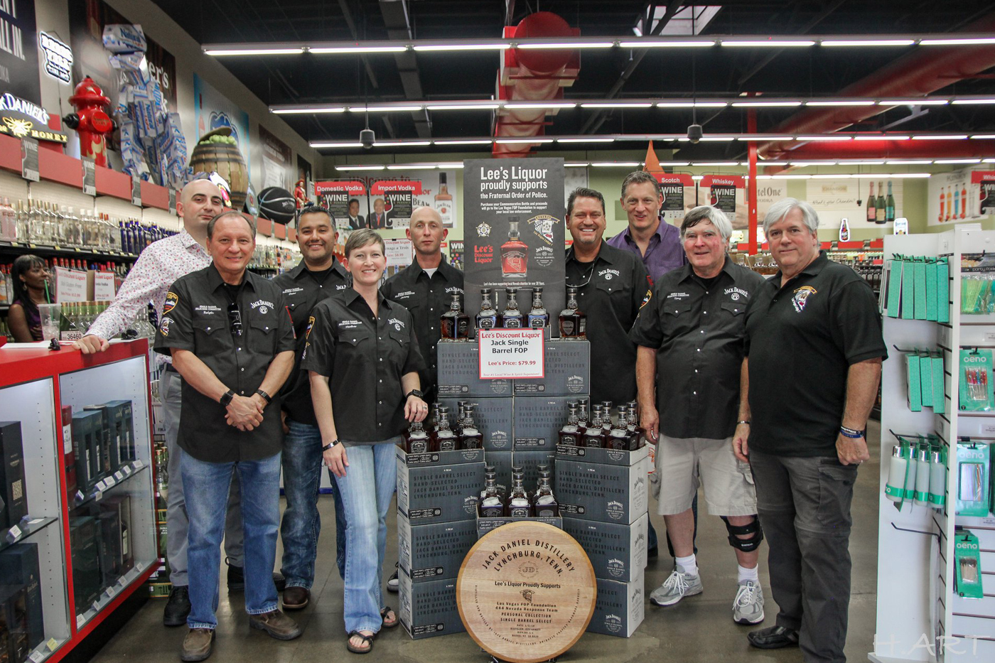 Members of Las Vegas Lodge #1 Fraternal Order of Police around the Jack Daniel's display
