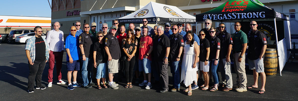 Members of the Las Vegas Lodge #1 Fraternal Order of Police smiling